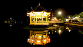 Building on the water, Chinese garden lights at night. Royalty Free Stock Images