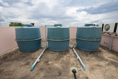 Building water storage tank on blue sky background Royalty Free Stock Image