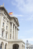 Building with waving Spanish flag Royalty Free Stock Photo