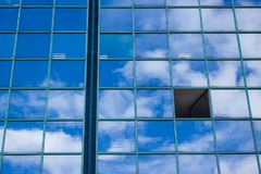 Building with window mirror and clouds Stock Photography