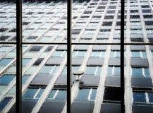 Building windows on rainy day Stock Photography