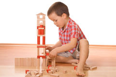 Building a wooden block castle Stock Photo