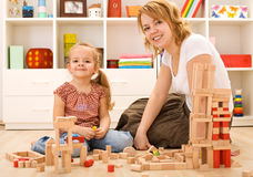 Building with wooden blocks Stock Images