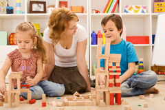 Building with wooden blocks together is fun Stock Images