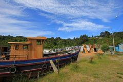 Building wooden boats by hand from tree trunks, Chiloe Island, Chile Royalty Free Stock Photos