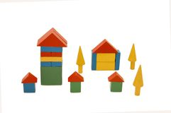 Building from wooden colourful blocks Royalty Free Stock Photography