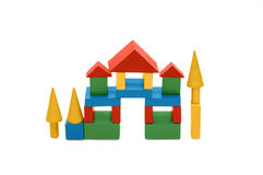 Building from wooden colourful childrens blocks Royalty Free Stock Image