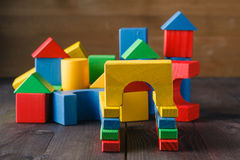 Building from wooden colourful childrens blocks Royalty Free Stock Photos