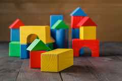 Building from wooden colourful childrens blocks Stock Images