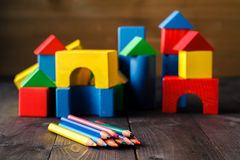 Building from wooden colourful childrens blocks Royalty Free Stock Images