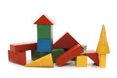 Building from wooden colourful childrens blocks Royalty Free Stock Photography