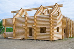 Building of wooden house. Building of house from wooden logs stock photo