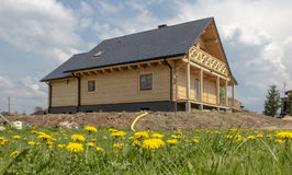Building of a wooden house on a meadow covered Stock Photo