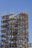 Building work. The top of a tall new building being supported by scaffolding royalty free stock photo
