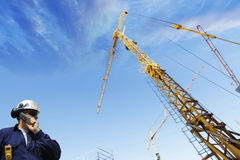Building worker, cranes and scaffolding Royalty Free Stock Image