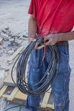Building worker with electrical cable Royalty Free Stock Image