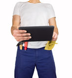 Building worker have information of work in the tablet Stock Image