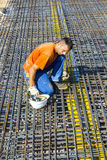 Building worker lays reinforcement Stock Image