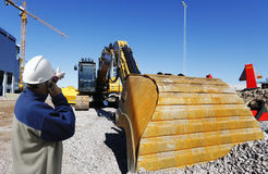 Building worker pointing at bulldozer Royalty Free Stock Photos