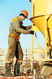 Building worker pouring concrete with barrel Royalty Free Stock Photography