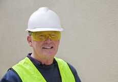 Building worker in safety gear. Building worker wears full safety gear at work Stock Photos