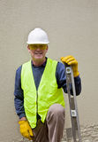 Building worker in safety gear. Building worker in full safety gear prepares for work Stock Photos