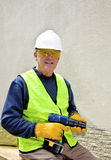 Building worker in safety gear. With drill Stock Photography