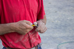 Free Building Worker Sharpening A Pencil With A Knife Stock Photos - 34495443