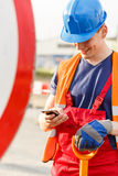 Building worker using a phone Stock Photography