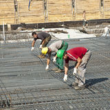 Building workers lay reinforcement Royalty Free Stock Photography