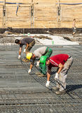 Building workers lay reinforcement Stock Photo