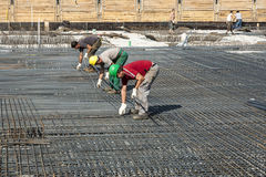 Building workers lay reinforcement Stock Photography