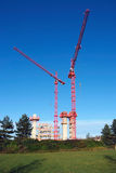 Building works. Two red cranes and building works royalty free stock photo