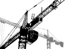 Building yard. Construction of a building. Silhouettes of the cranes Royalty Free Stock Image