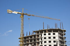 Building yard with construction crane. On a blue sky Stock Photo