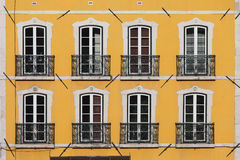 Building with Yellow Facade Stock Image