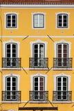 Building with Yellow Facade Stock Photo
