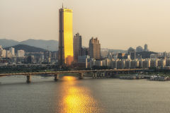 63 building. In yeouido, seoul, south korea, reflecting the sunset light on the han river Royalty Free Stock Photo