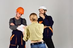 Building your dream home. Professional people working on construction design. Group of constructing engineers and. Architects at work. Construction workers team royalty free stock photo