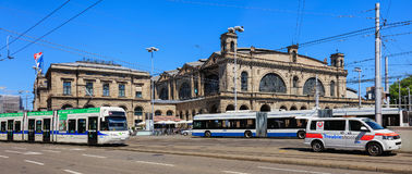 Building of the Zurich main railway station, traffic in front of. Zurich, Switzerland - 18 June, 2017: the building of the Zurich main railway station, traffic stock images