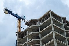 Buildingl crane. Construction of a new building Stock Photography