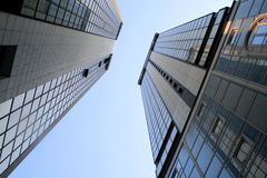 Buildings. A couple of buildings in the sky royalty free stock photography