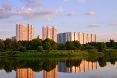 Buildings. Multistoried dwelling building on a background sky during sunset Stock Images