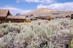Buildings in the abandoned ghost town of Bodie California. Bodie was a busy, high elevation gold mining town in the Sierra Nevada. Mountains in the early 1900s stock images