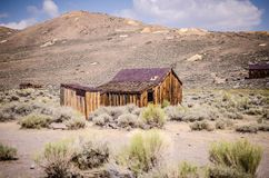 Buildings in the abandoned ghost town of Bodie California. Bodie was a busy, high elevation gold mining town in the Sierra Nevada. Mountains in the early 1900s stock photography