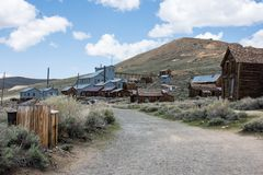 Buildings in the abandoned ghost town of Bodie California. Bodie was a busy, high elevation gold mining town in the Sierra Nevada. Mountains in the early 1900s royalty free stock photography