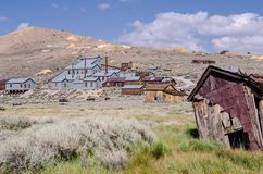 Buildings in the abandoned ghost town of Bodie California. Bodie was a busy, high elevation gold mining town in the Sierra Nevada. Mountains in the early 1900s royalty free stock images