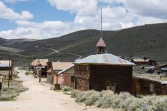 Buildings in the abandoned ghost town of Bodie California. Bodie was a busy, high elevation gold mining town in the Sierra Nevada. Mountains in the early 1900s stock photos