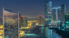 Buildings on Al Reem island in Abu Dhabi day to night timelapse from above. Skyscrapers on Al Reem Island in Abu Dhabi day to night transition timelapse after stock video footage