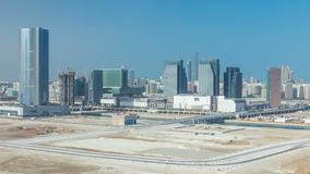 Buildings on Al Reem island in Abu Dhabi timelapse from above. Aerial citiscape of Al Reem Island at morning, showing the reflection on skyscrapers and stock video footage